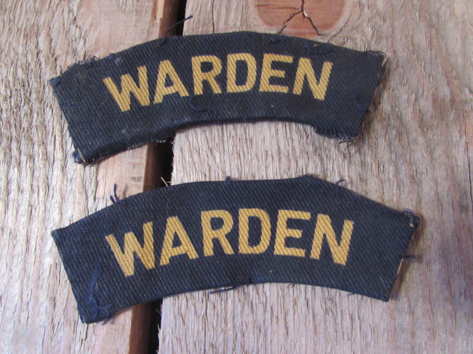 Pair of wartime warden shoulder titles (material)