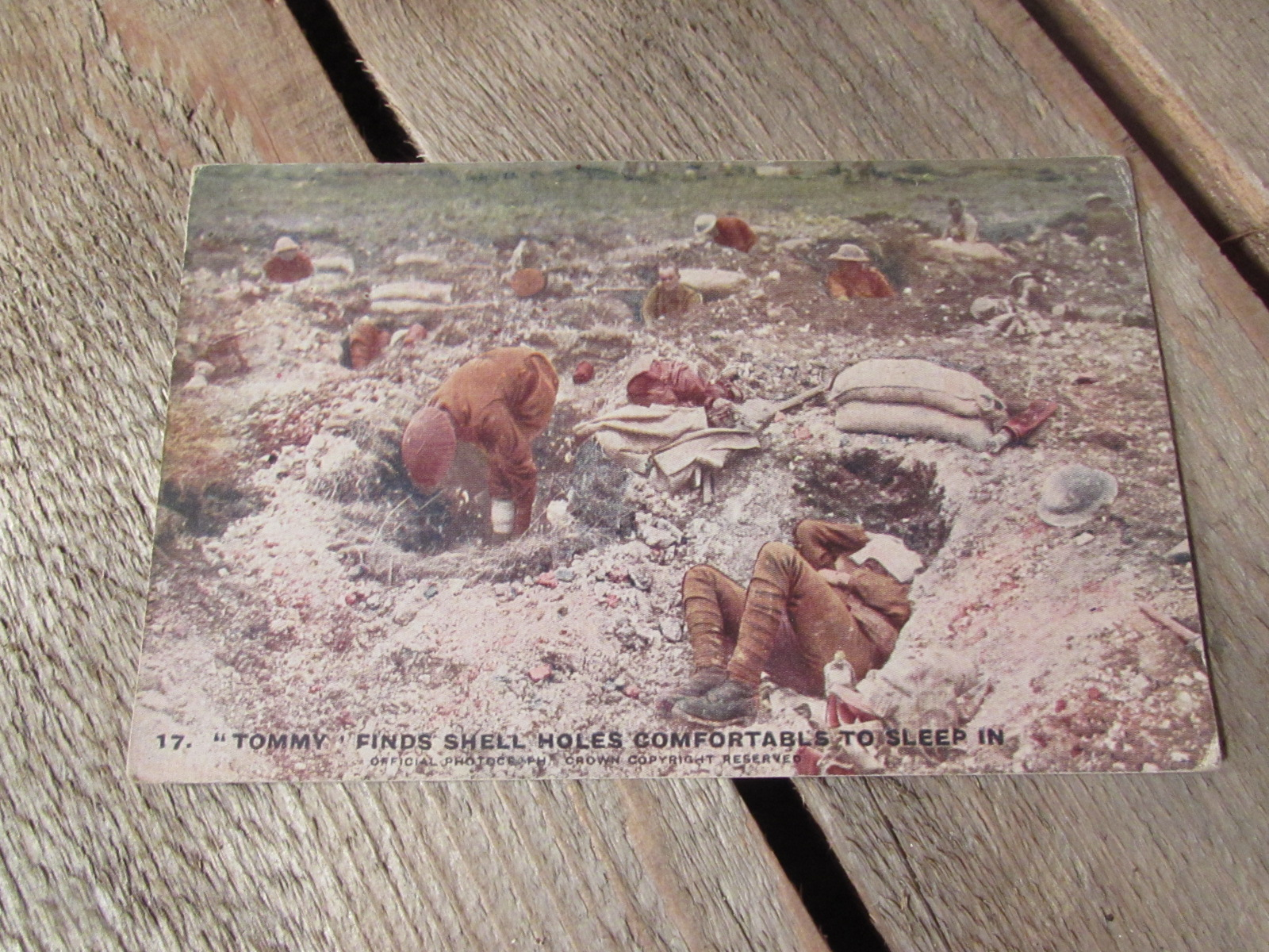 WW1 Original postcard (colourised). Tommy taking a nap on the front line